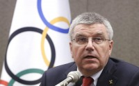 FILE - In this Wednesday, Aug. 19, 2015 file photo, International Olympic Committee (IOC) President Thomas Bach speaks during a press conference in Seoul, South Korea. Russia's track and field athletes will be cleared to compete in the Olympics in Rio de Janeiro in August, only if the country falls into line with all global anti-doping rules and the reforms are independently verified, IOC President Thomas Bach said in an interview Sunday Nov. 15, 2015, with The Associated Press. (AP Photo/Ahn Young-joon, File)